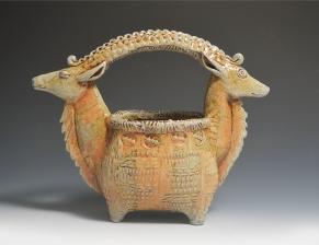 double headed goat basket orange